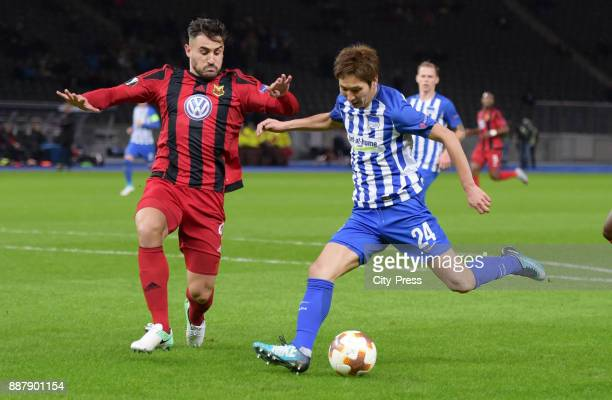 Sotiris Papagiannopoulos of Oestersunds FK and Genki Haraguchi of Hertha BSC during the Uefa Europa League Group J match between Hertha BSC and...