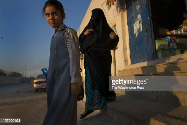 Souad AlShamir and nineyearold daughter Rahaf head to school after purchasing chips at a local store in Riyadh Saudi Arabia on October 8 2012 Shamir...