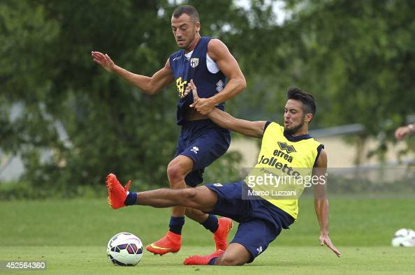 Soufiane Bidaoui competes for the ball with Cristobal Djorquera during FC Parma Training Session at the club's training ground on July 23 2014 in...