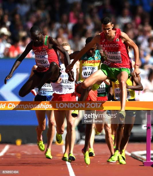 Soufiane Elbakkali of Morocco and Jairus Kipchoge Birech of Kenya compete in the Men's 3000 metres Steeplechase heats during day three of the 16th...