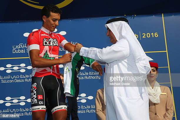 Soufiane Haddi of Marocco and Skydive Dubai Pro Cycling Team receives the UAE Flag Jersey for the Intermediate Sprint classification during the Dubai...