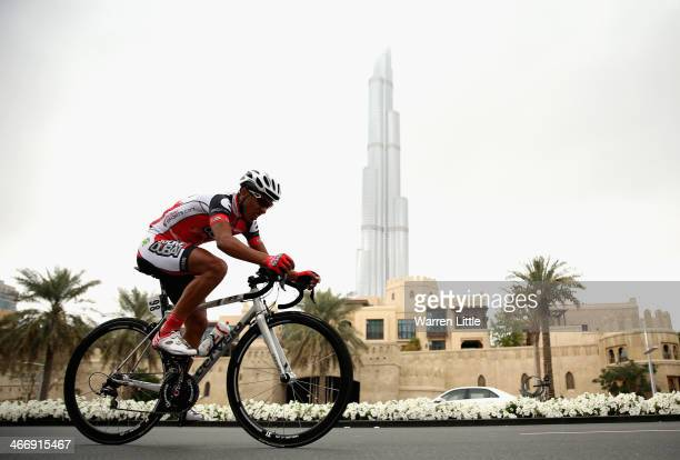 Soufiane Haddi of Morroco and Skydive Dubai Pro Cycling team races past the Burj Khalifa during the time trial on stage one of the 2014 Tour of Dubai...