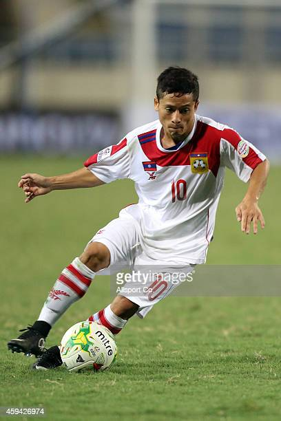 Souk Aphone of Laos controls the ball during the 2014 AFF Suzuki Cup Group A match between the Philippines and Laos at the My Dinh Stadium on...