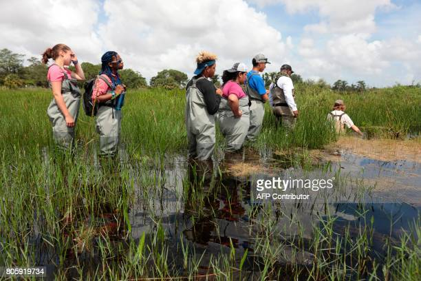 Soul River group walks in a river at the Arthur R Marshall Loxahatchee National Wildlife Refugee in Boynton Beach Florida on June 19 2017 Founded by...