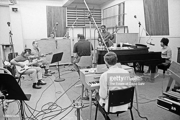 Soul singer Aretha Franklin at the piano and clockwise from top Jerry Jemmott Spooner Oldham Tommy Cogbill Jimmy Johnson Roger Hawkins and producer...