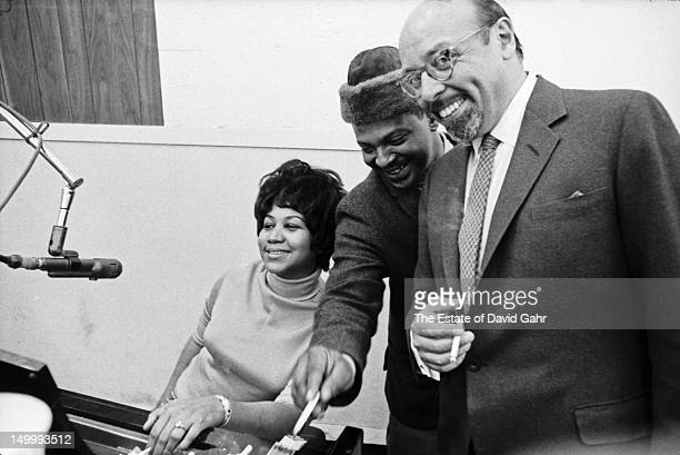 Soul singer Aretha Franklin Franklin's husband and manager Ted White and Atlantic Records founder and president Ahmet Ertegun pose for a portrait at...