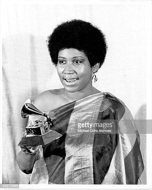 Soul singer Aretha Franklin holds the Grammy award that she won in circa 1971