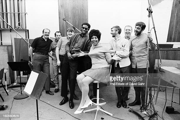 Soul singer Aretha Franklin poses for a portrait in April 1968 at Atlantic Records studios with producer Arif Mardin famed Muscle Shoals musicians...