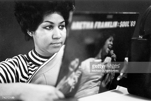 Soul singer Aretha Franklin reviews a copy of her album 'Aretha Franklin Soul '69' at Atlantic Records studios on January 9 1969 in New York City New...