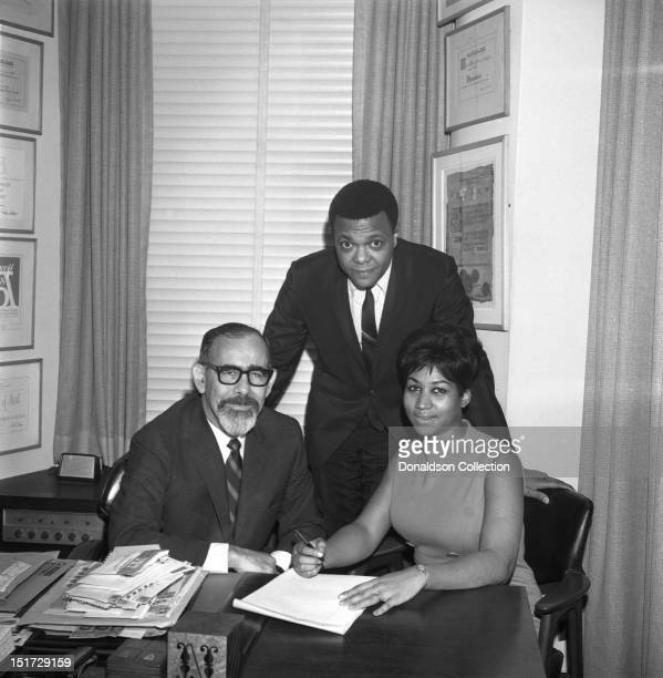 Soul singer Aretha Franklin signs her contract with Atlantic Records on November 21 1966 in New York City New York