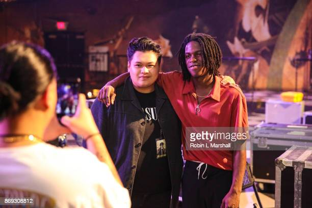 Soul Singer Daniel Caesar poses with fan at The Fonda Theatre on November 1 2017 in Los Angeles California