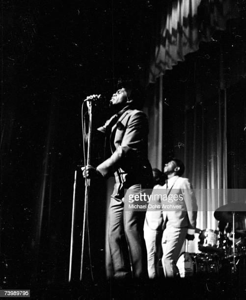 Soul singer James Brown performs onstage at the Apollo Theatre with the Famous Flames in 1964 in New York New York