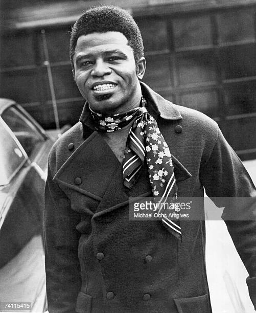 Soul singer James Brown poses for a portrait wearing a scarf in circa 1965