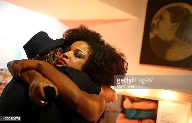 Soul singer Jesuton hugs a friend in her dressing room prior to performing at the historic Teatro Rival on June 4 2014 in Rio de Janeiro Brazil The...