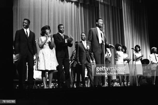 Soul singer Marvin Gaye performs as Martha and the Vandellas and others back him up circa mid1964 at the Apollo Theater in Harlem New York