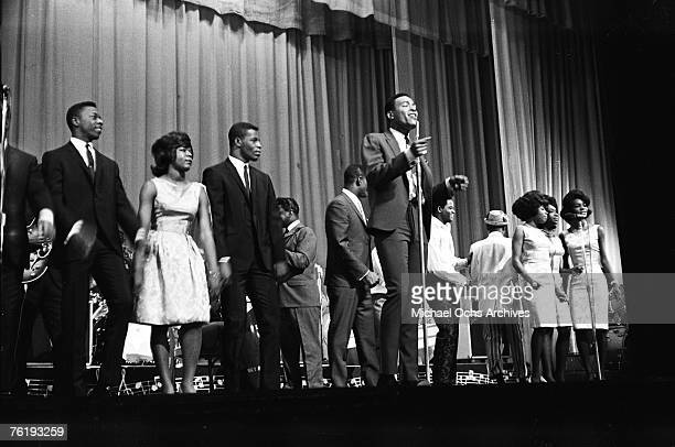Soul singer Marvin Gaye performs as Martha and the Vandellas Joe Tex and others back him up circa mid1964 at the Apollo Theater in Harlem New York