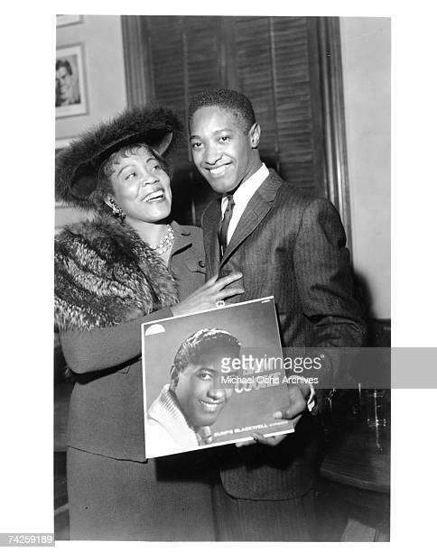 Soul singer Sam Cooke holds up his eponymous debut album as he poses for a photo with Gertrude Hall circa 1958 in Los Angeles California