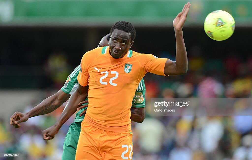 Souleman Bamba of Ivory Coast jumps for a header during the 2013 Orange African Cup of Nations 3rd Quarter Final match between Ivory Coast and...