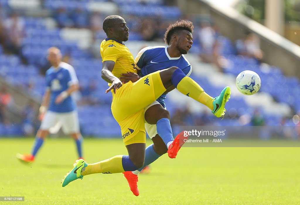 Souleman Bamba of Leeds United and Shaquile Coulthirst of Peterborough United during the PreSeason Friendly match between Peterborough United and...
