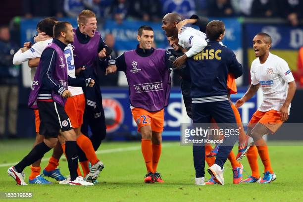 Souleymane Cam marao0 celebrates the second goal during the UEFA Champions League group B match between FC Schalke 04 and Montpellier Herault SC at...