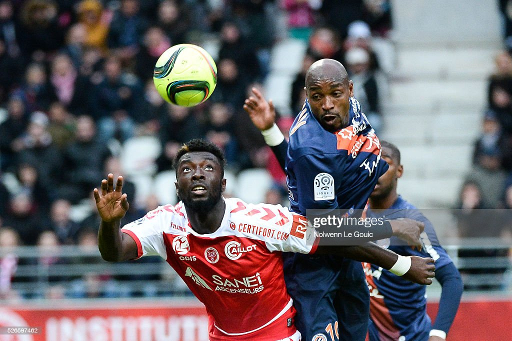 Souleymane Camara of Montpellier and Grejonh Kyei of Reims during the French Ligue 1 match between Stade de Reims and Montpellier Herault SC at Stade Auguste Delaune on April 30, 2016 in Reims, France.