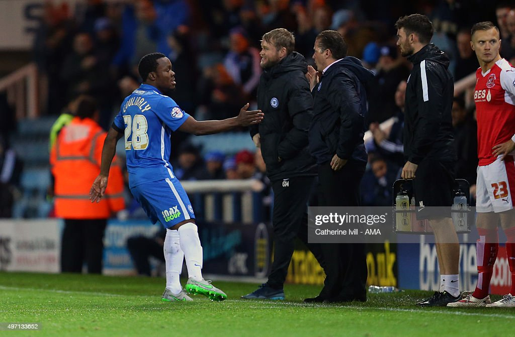 Souleymane Coulibaly of Peterborough United celebrates after scoring to make it 1-0 with Graham Westley manager of Peterborough United during the Sky Bet League One match between Peterborough United and Fleetwood Town at London Road Stadium on November 14, 2015 in Peterborough, England.