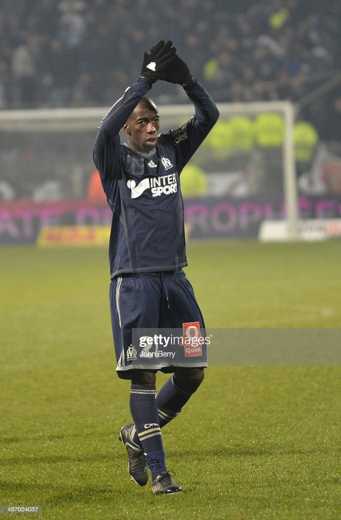 <a gi-track='captionPersonalityLinkClicked' href=/galleries/search?phrase=Souleymane+Diawara&family=editorial&specificpeople=695613 ng-click='$event.stopPropagation()'>Souleymane Diawara</a> of Marseille thanks his supporters after the french Ligue 1 match between Olympique Lyonnais, OL, and Olympique de Marseille, OM, at the Stade Gerland on December 15, 2013 in Lyon, France.