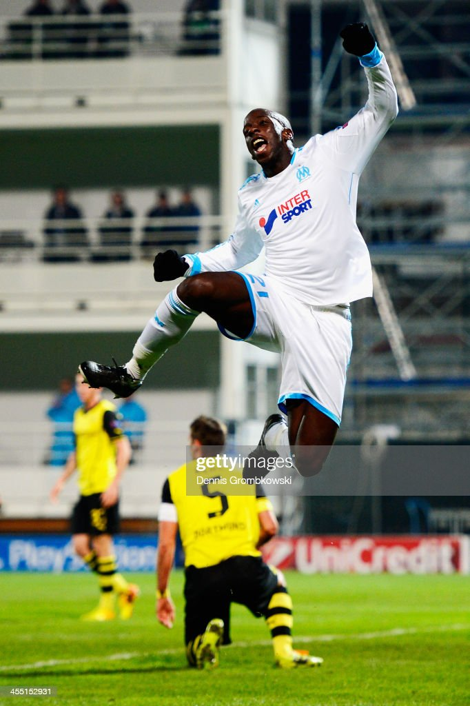<a gi-track='captionPersonalityLinkClicked' href=/galleries/search?phrase=Souleymane+Diawara&family=editorial&specificpeople=695613 ng-click='$event.stopPropagation()'>Souleymane Diawara</a> of Olympique de Marseille celebrates first goal during the UEFA Champions League Group F match between Olympique de Marseille and Borussia Dortmund at Stade Velodrome on December 11, 2013 in Marseille, France.
