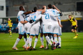 Souleymane Diawara of Olympique de Marseille celebrates with teammates after scoring his team's first goal during the UEFA Champions League Group F...