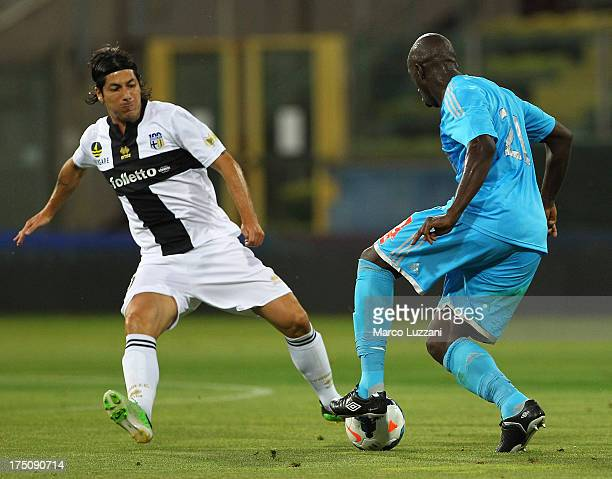 Souleymane Diawara of Olympique de Marseille competes for the ball with Jaime Valdes of Parma FC during the preseason friendly match between Parma FC...