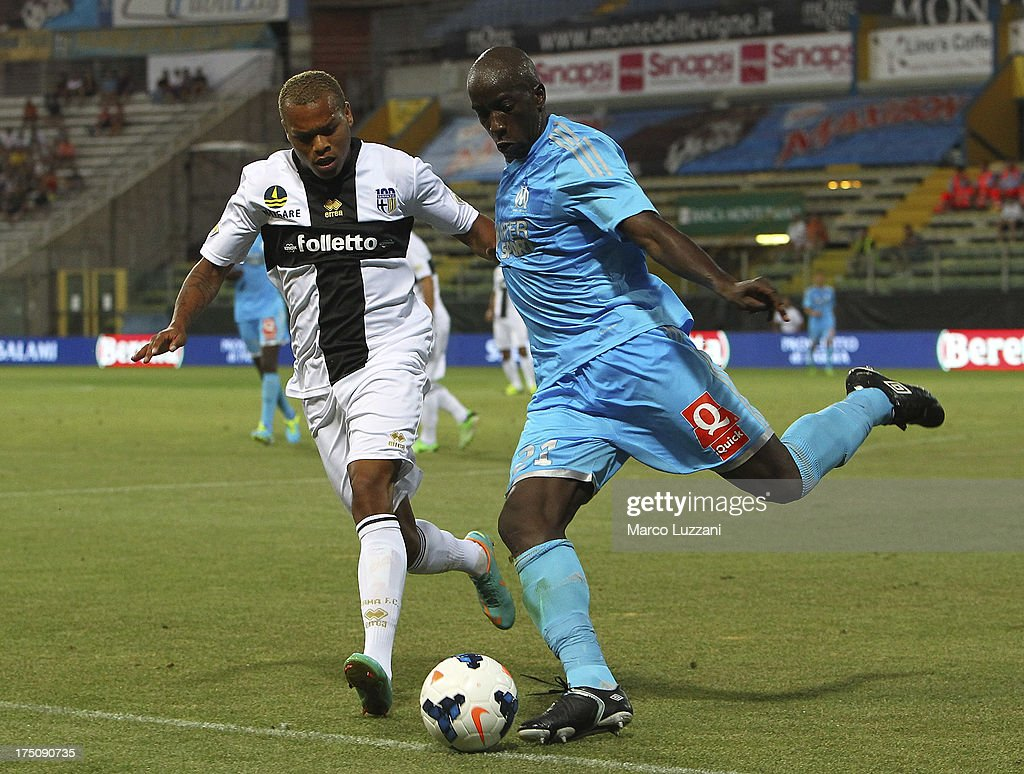 Souleymane Diawara (R) of Olympique de Marseille competes for the ball with Jonathan Biabiany (L) of Parma FC during the pre-season friendly match between Parma FC and Olympique de Marseille at Stadio Ennio Tardini on July 31, 2013 in Parma, Italy.