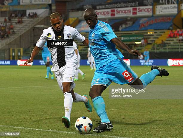Souleymane Diawara of Olympique de Marseille competes for the ball with Jonathan Biabiany of Parma FC during the preseason friendly match between...