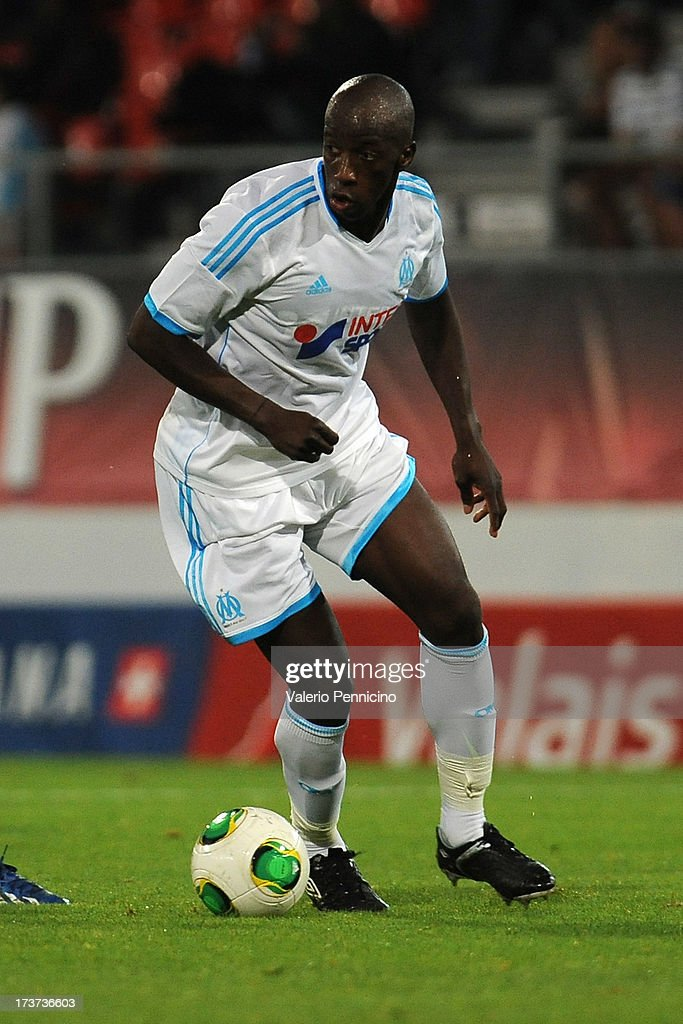 <a gi-track='captionPersonalityLinkClicked' href=/galleries/search?phrase=Souleymane+Diawara&family=editorial&specificpeople=695613 ng-click='$event.stopPropagation()'>Souleymane Diawara</a> of Olympique Marseille in action during the pre-season friendly match between FC Porto and Olympique Marseille at Estadio Tourbillon on July 13, 2013 in Sion, Switzerland.