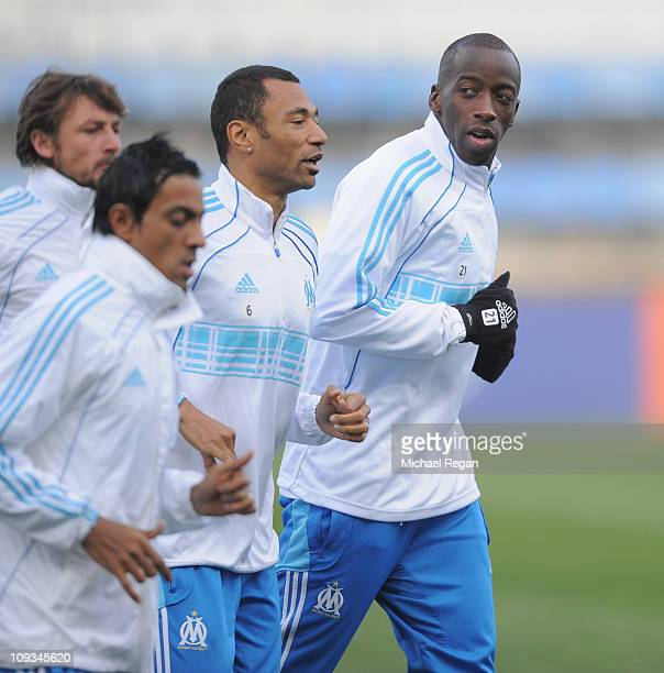 Souleymane Diawara warms up with team mates during the Marseille training session at Stade Veledrome on February 22 2011 in Marseille France