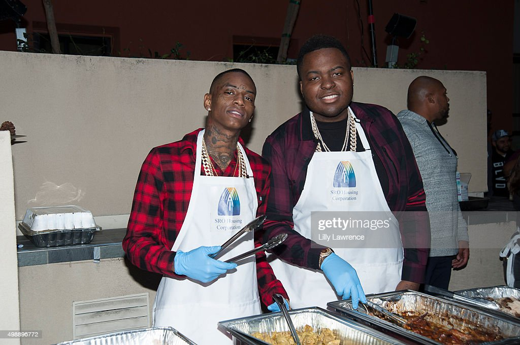 Soulja Boy and Sean Kingston serve Thanksgiving dinner on Skid Row at Thanksgiving with the Kingstons on November 26 2015 in Los Angeles California