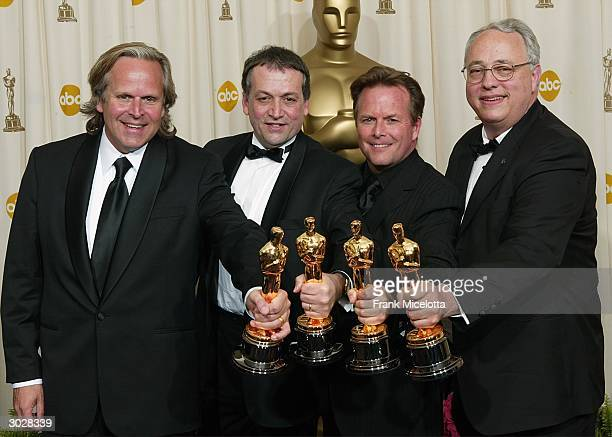 Sound Editors Hammond Peek Michael Hedges Michael Semanick and Christopher Boyes pose with their Oscar during the 76th Annual Academy Awards at the...