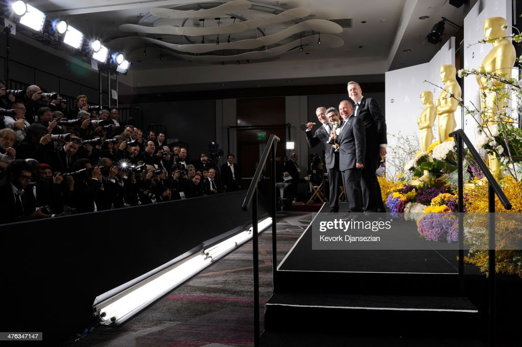 Sound editors Skip Lievsay, Niv Adiri, Christopher Benstead, and Chris Munro, winners of Best Achievement in Sound Mixing pose in the press room during the Oscars at Loews Hollywood Hotel on March 2, 2014 in Hollywood, California.