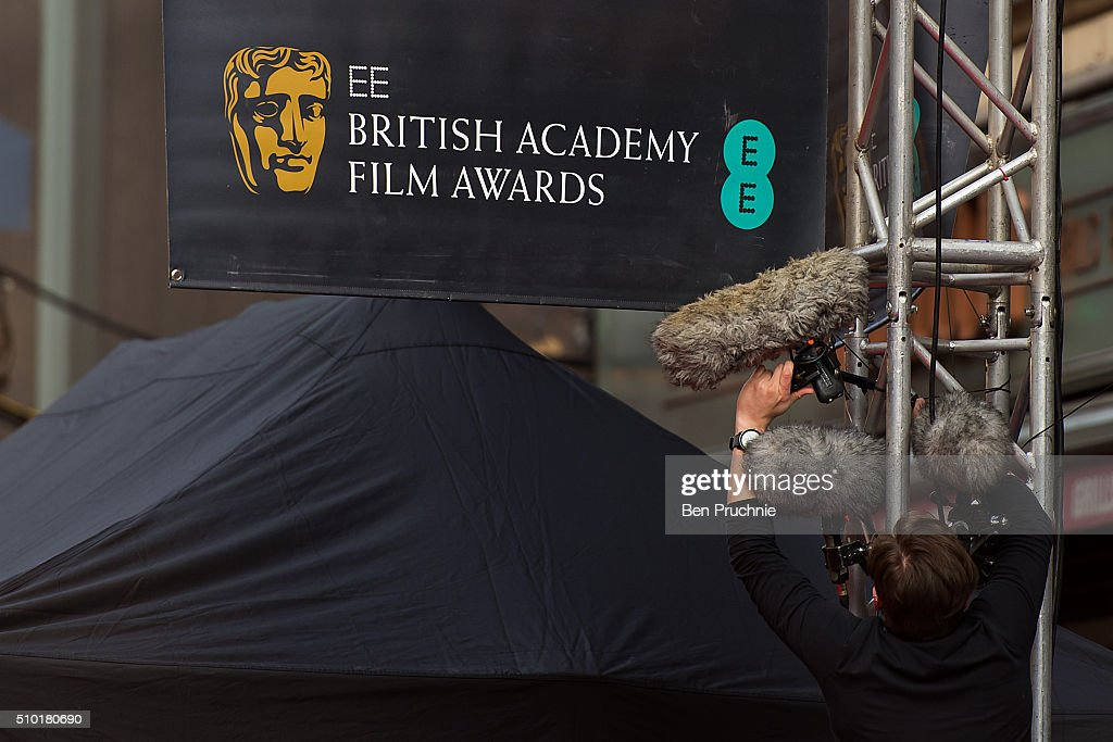 A sound engineer instals microphones ahead of the 69th EE British Academy Film Awards at The Royal Opera House on February 14, 2016 in London, England.