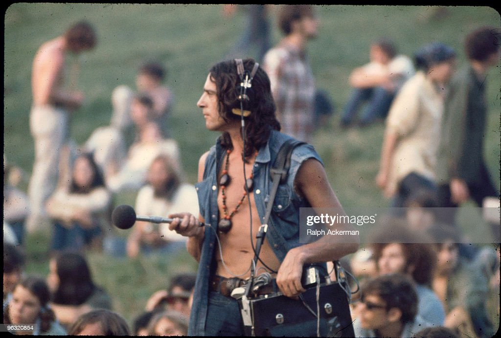 Sound Guy with mic and Nagra near Free Stage, at the Woodstock music festival, August 1969.