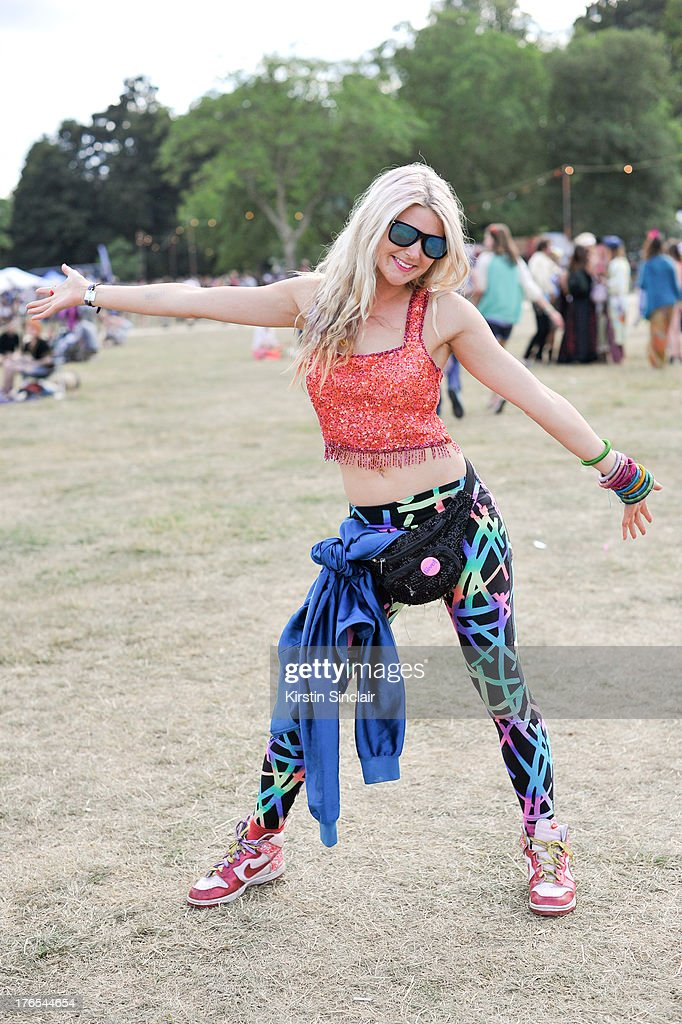 Sound Healer Cherub Sanson wears sunglasses from Thailand, trousers from Hong Kong, Bumbag from Barli, vintage trainers and a Beyond Retro top on day 3 of Wilderness Festival on August 10, 2013 in Cornbury Park, Oxfordshire, England.