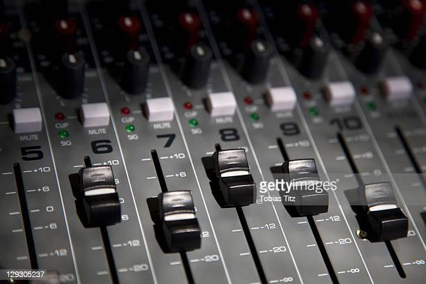 A sound mixing board, close-up, full frame
