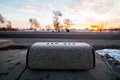 Bluetooth Speaker on the street at Sunrise
