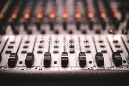 sound studio recording equipment music mixer controls at concert