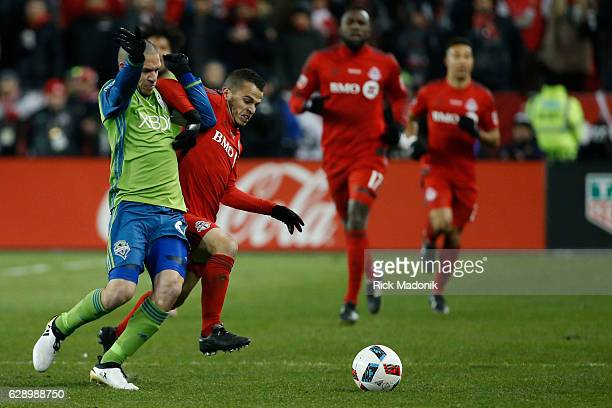 Sounders Osvaldo Alonso fends off Toronto FC forward Sebastian Giovinco Toronto FC vs Seattle Sounders in 1st half action of MLS Cup final in Toronto...
