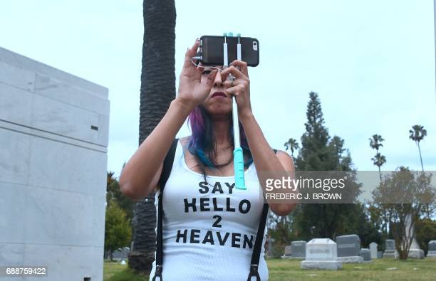 Soundgarden fan Melody Andrade wearing a 'Say Hello 2 Heaven' tshirt attends the funeral service for Soundgarden frontman Chris Cornell on May 26...
