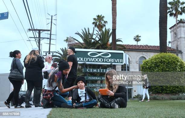 Soundgarden fans including Melody Andradeis seen with her son Jude both wearing a 'Say hello 2 Heave' tshirt joining others waiting outside the...