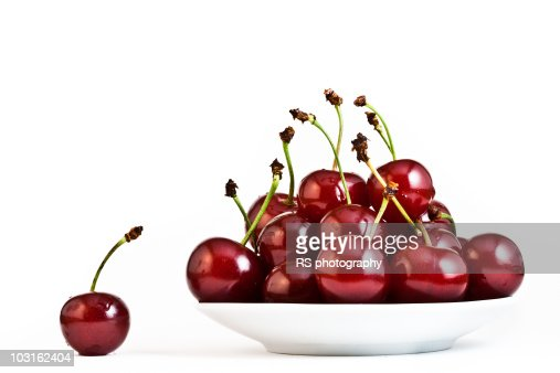 Sour cherries on white background