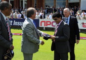 Sourav Ganguly and Bob Willis receive caps from ECB Chairman Giles Clarke and Honorary Joint Secretary of the BCCI Sanjay Jagdale in honour of the...