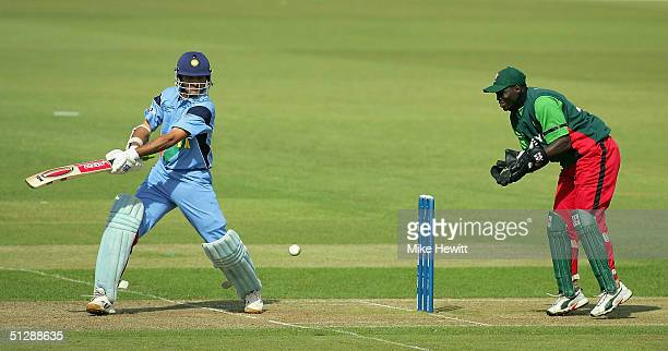 Sourav Ganguly of India cuts for four during his 90 run innings as Kennedy Otieno of Kenya looks on during the ICC Champions Trophy match between...