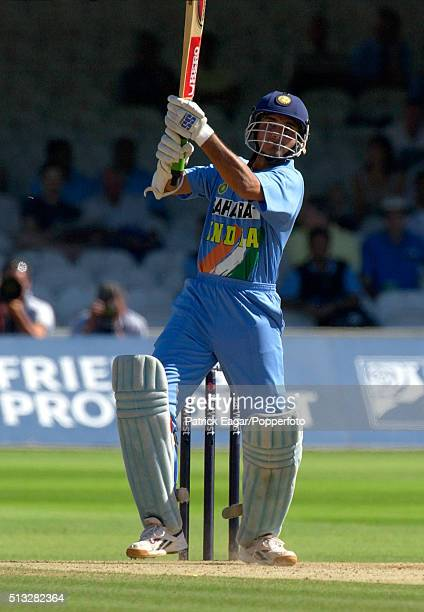 Sourav Ganguly of India hits Darren Gough for six during his innings of 90 runs in the NatWest Challenge One Day International between England and...